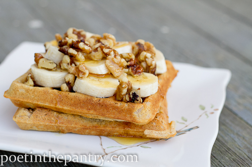 whole wheat waffles topped with banana, walnuts, and local raw honey