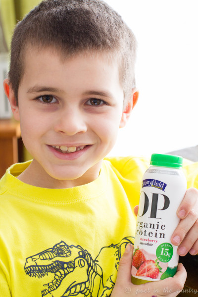 my son trying Stonyfield OP Organic Protein Smoothies - Poet in the Pantry