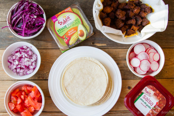 Make any night taco night with some tasty chorizo and an assortment of toppings, including Sabra's new Veggie Fusions guacamole! {sponsored post} #VeggieFusionsguac #veggieupyourguac