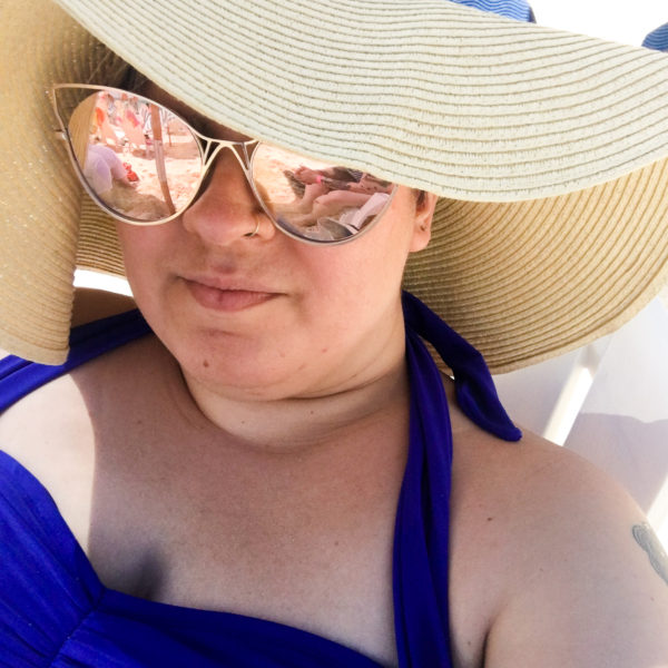 me in a big hat and sunglasses on the beach, Freeport, Bahamas