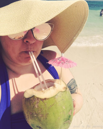 coconut drinks on a private beach in Freeport, Bahamas