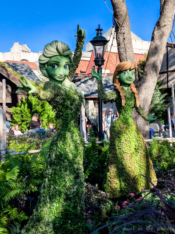 Frozen's Anna and Elsa topiaries at Epcot 2018