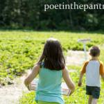 kids running through strawberry fields