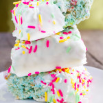 Peeps Cereal Squares are like the Rice Krispie Treats you've grown to love...only better, with the addition of Fruity Pebbles, Peeps (instead of marshmallows), and a vanilla coating on the outside to make a heck of a treat!