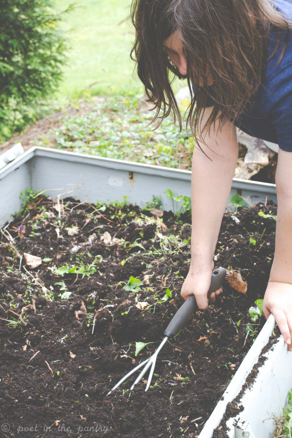 what a mess to clean up! but OXO's cultivator helped her pull out the stubborn weeds and loosen up the soil in no time!