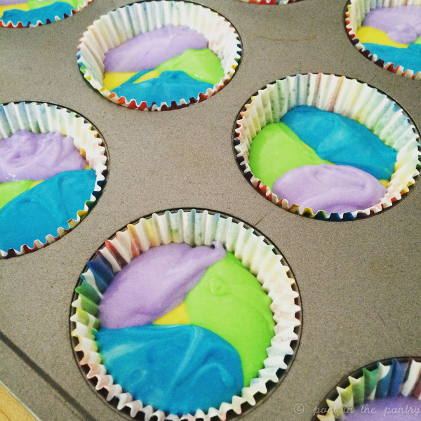 For rainbow cupcakes, the batter gets dropped, one color at a time, in the muffin cups to create a pretty tie-dye effect