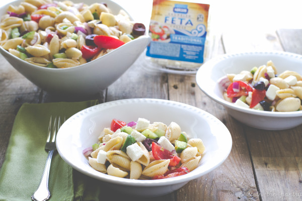 Greek Pasta Salad, featuring Nikos Traditional Feta, is an easy dish to bring to all your summer parties & picnics!
