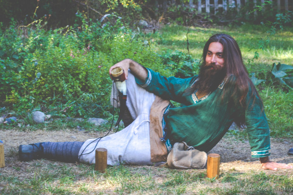 Our host taunts us during a game of kubb, a Viking lawn game - The New York Renaissance Faire