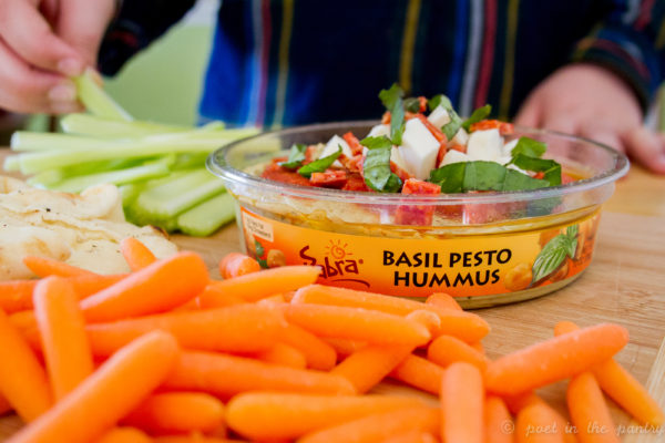 Pepperoni Pizza Hummus makes for a great pre-dinner snack, gathering the family in the kitchen to share the details of their day as dinner comes together. {sponsored post}