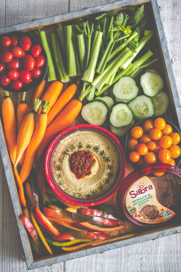 A hummus board featuring Sabra hummus is a great way to celebrate summer's end.