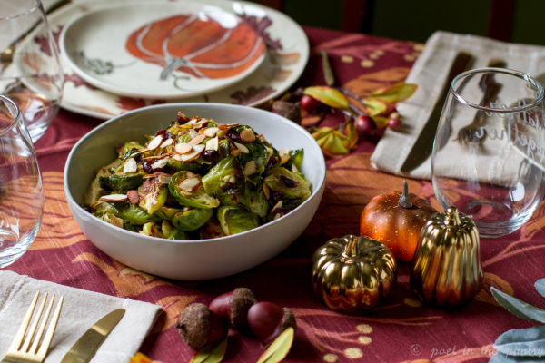 Roasted Brussels Sprouts with Dried Cranberries over Hummus